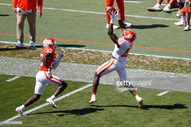 Ajou Ajou of the Clemson Tigers makes a reception as Andrew Booth Jr. #23 defends during the second half of the Clemson Orange and White Spring Game...