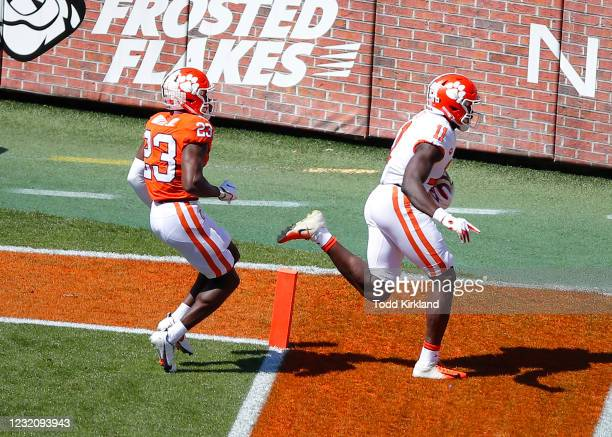 Ajou Ajou of the Clemson Tigers scores a touchdown as Andrew Booth Jr. #23 defends during the second half of the Clemson Orange and White Spring Game...