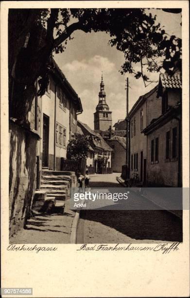 Ak Bad Frankenhausen Oberkirchgasse mit Blick zur Kirche