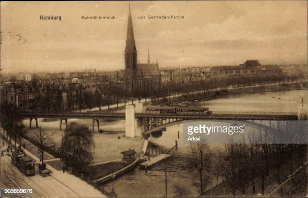 Ak Hamburg Nord Uhlenhorst Partie am Kuhmühlenteich mit Gertruden Kirche