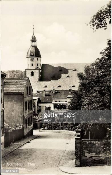 Ak Schmölln in Thüringen Straßenpartie mit Blick auf Kirche Häuser