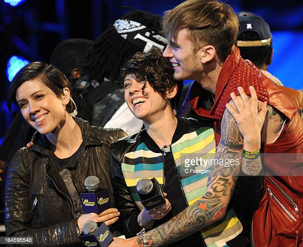 Aka. Machine Gun Kelly wins the Woodie of the Year award presented by Tegan Quin and Sara Quin of Tegan and Sara during the 2013 mtvU Woodie Awards...
