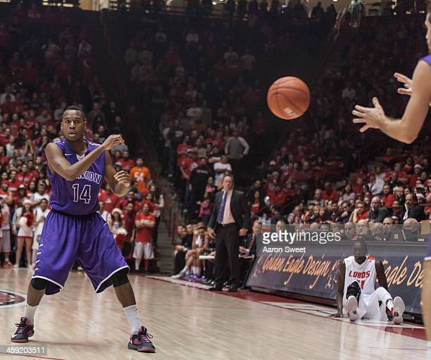 Akachi Okugo of the Grand Canyon Antelopes passes the ball down the lane during the Monday night game against the New Mexico Lobos at The Pit on...