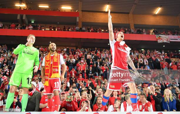 Akagi Gogia and Sebastian Polter of 1 FC Union Berlin celebrate after their team is promoted to the first Bundesliga for the first time in the club's...