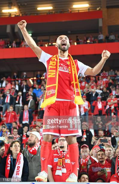 Akagi Gogia of Union Berlin celebrates after his team is promoted to the first Bundesliga for the first time in the club's history after the...