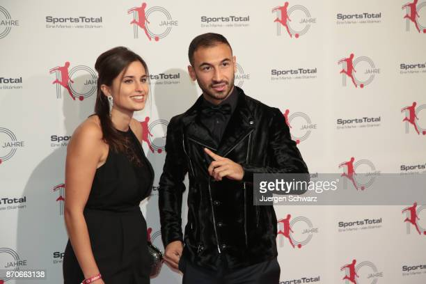 Akaki Gogia and his girlfriend Andrea pose at the 10th anniversary celebration of the Sports Total Agency on November 5 2017 in Cologne Germany