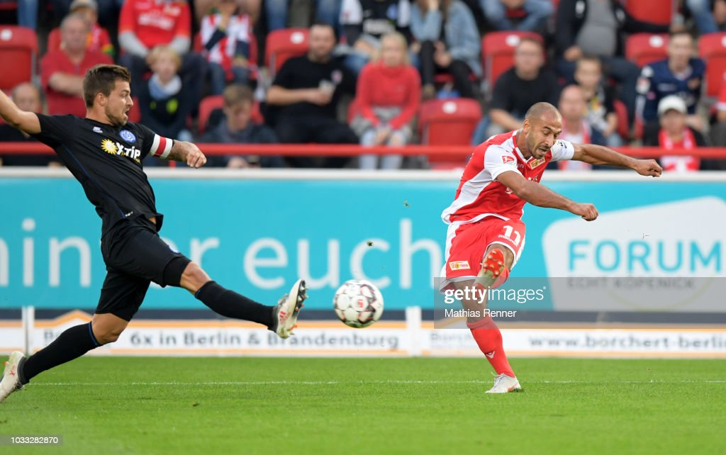 Akaki Gogia of 1 FC Union Berlin scores the 1:0 next to Kevin Wolze of MSV Duisburg during the game between Union Berlin and the MSV Duisburg at the Stadion an der Alten Foersterei on september 14, 2018 in Berlin, Germany.