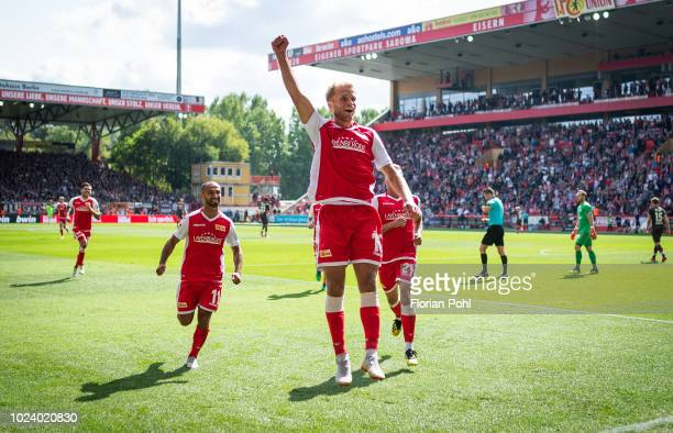 Akaki Gogia, Sebastian Andersson and Grischa Proemel of 1.FC Union Berlin celebrate after scoring the 3:0 during the 2nd Bundesliga match between...