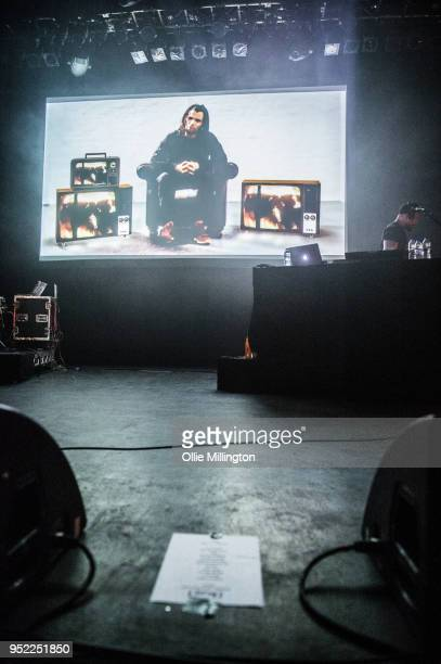 Akala visuals play an introduction to his graphic novel Visions before he performs on stage at O2 Shepherd's Bush Empire on April 27 2018 in London...