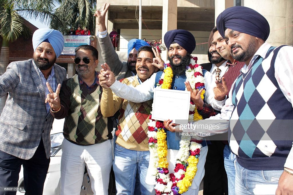 Akali supporters celebrating victory with winning SAD councilor Hardeep Singh after MC election results at Sector 42 on December 20 2016 in...