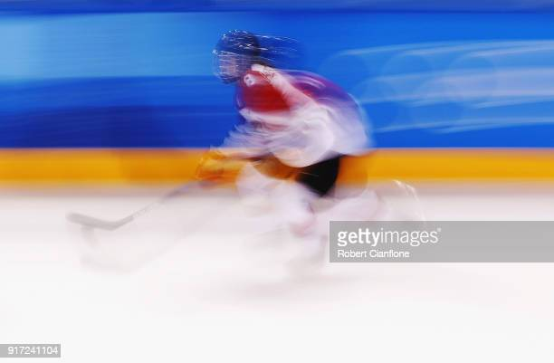Akane Hosoyamada of Japan skates with the puck in the second period against Switzerland during the Women's Ice Hockey Preliminary Round - Group B...