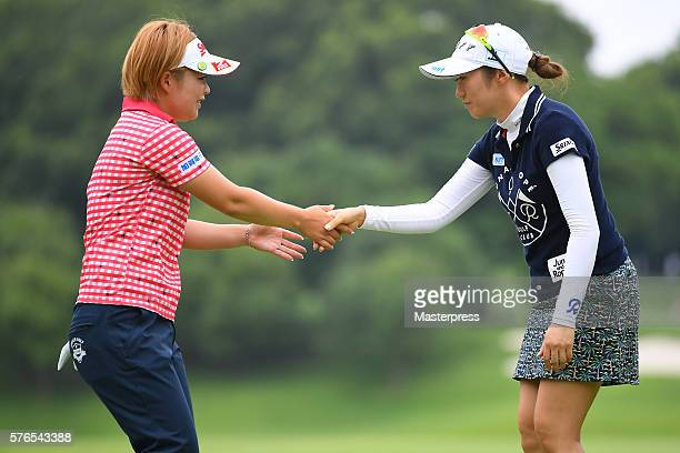 Akane Iijima and Hiroko Azuma of Japan shake hands during the second round of the Samantha Thavasa Girls Collection Ladies Tournament 2016 at the...