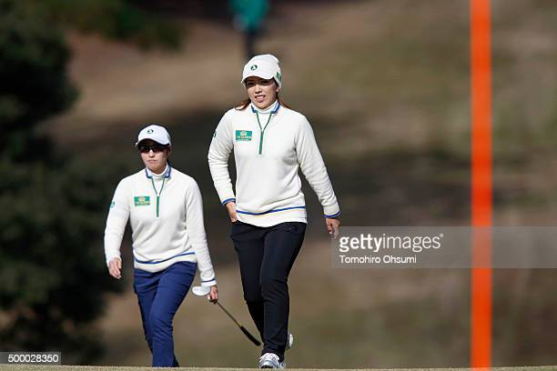 Akane Iijima left and Ritsuko Ryu of the Ladies Professional Golf Association of Japan team walk on the 10th hole during the second round of THE...