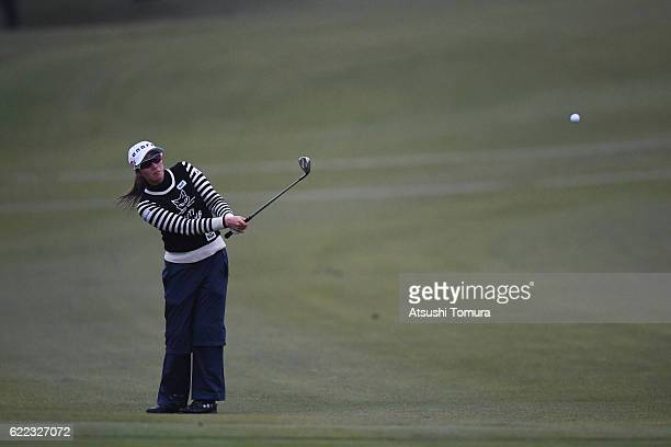 Akane Iijima of Japan chips onto the 18th green during the first round of the Itoen Ladies Golf Tournament 2016 at the Great Island Club on November...