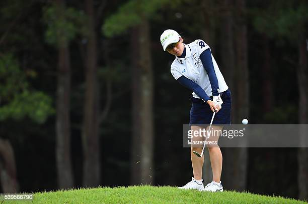 Akane Iijima of Japan chips onto the 5th green during the final round of the Suntory Ladies Open at the Rokko Kokusai Golf Club on June 12 2016 in...