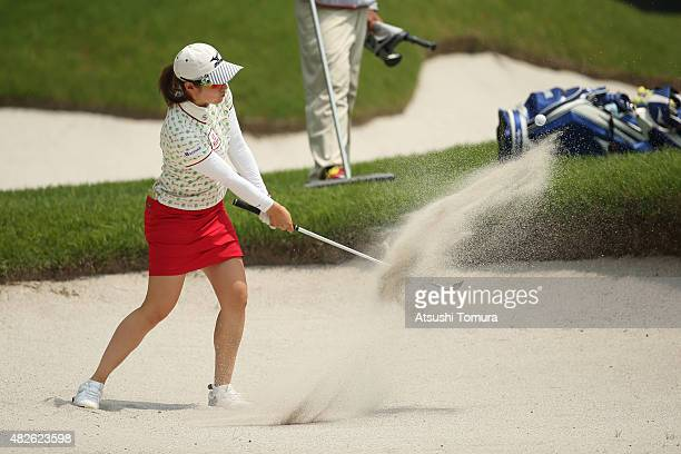 Akane Iijima of Japan hits from a bunker on the 18th hole during the second round of the Daito Kentaku Eheyanet Ladies 2015 at the Narusawa Golf Club...