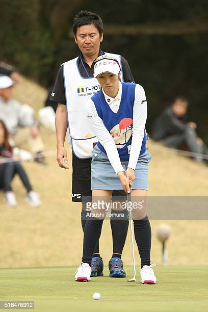 Akane Iijima of Japan lines up her birdie putt on the 8th green during the second round of the T-Point Ladies Golf Tournament at the Wakagi Golf Club...