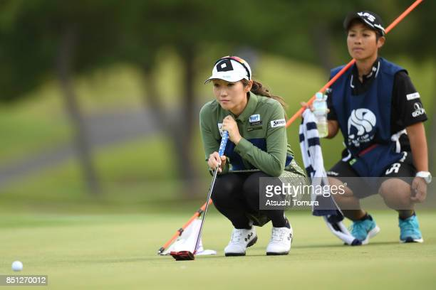 Akane Iijima of Japan lines up her putt on the 18th hole during the first round of the Miyagi TV Cup Dunlop Ladies Open 2017 at the Rifu Golf Club on...