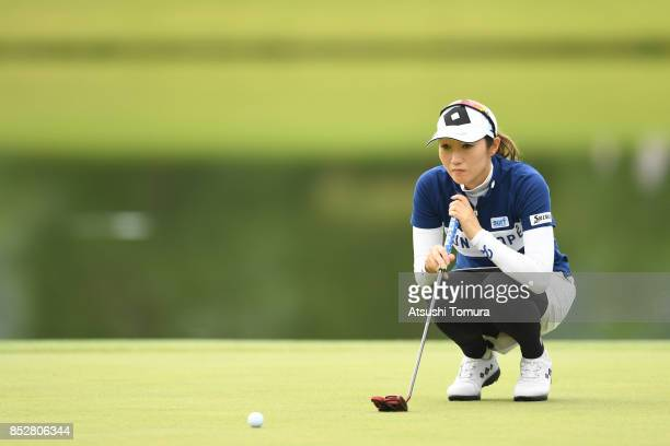 Akane Iijima of Japan lines up her putt on the 4th green during the final round of the Miyagi TV Cup Dunlop Ladies Open 2017 at the Rifu Golf Club on...