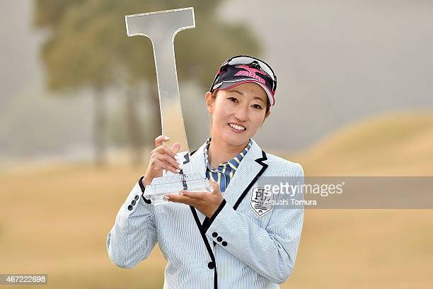 Akane Iijima of Japan poses with the trophy after winning the T-Point Ladies Golf Tournament at the Wakagi Golf Club on March 22, 2015 in Takeo,...