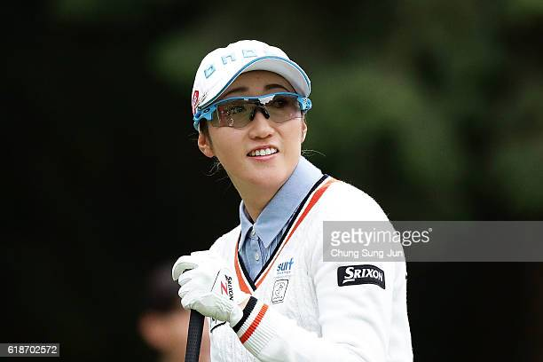 Akane Iijima of Japan reacts after a tee shot on the 2nd hole during the first round of the Higuchi Hisako Ponta Ladies at the Musashigaoka Golf...