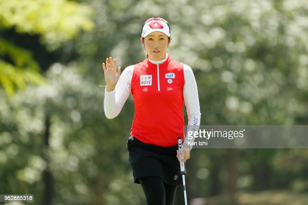 Akane Iijima of Japan reacts after her putt on the 15th green during the final round of the CyberAgent Ladies Golf Tournament at Grand fields Country...