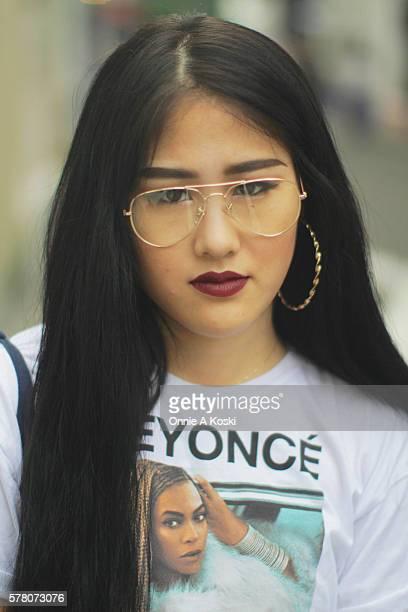 Akane Kagawa is wearing an LA Beyoncé concert tshirt HM black skinny jeans Timberland black boots a gold Casio watch and a Beams Boy white paisley on...