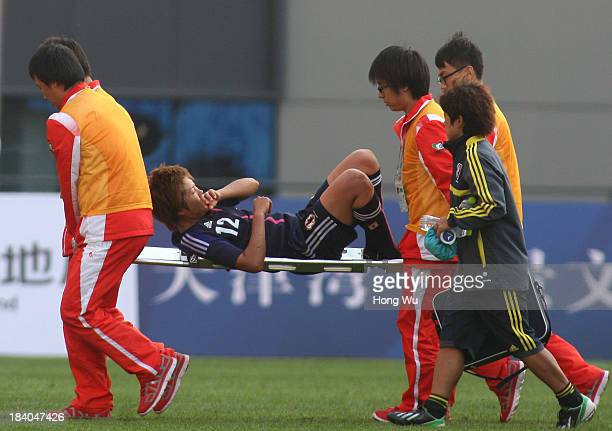 Akane Saito of Japan lays on the stretcher after injured during the 6th East Asian Games Women's Football match between Japan and North Korea at...