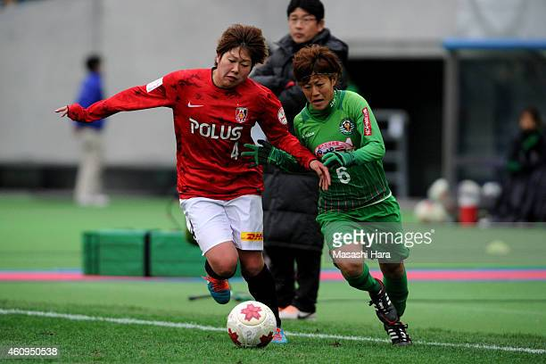 Akane Saito of Urawa Reds Ladies and Saori Ariyoshi of NTV Beleza compete for the ball during the 36th Emperess's Cup final match between NIPPON TV...