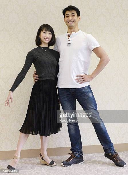 Akane Takada and Ryoichi Hirano who are to become principal dancers with Britain's Royal Ballet pose for photos during a press conference in Tokyo on...