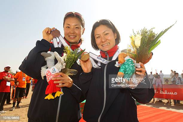 Akane Tsuchihashi of Japan and Juri Ide of Japan pose with their medals following the Women's Triathlon event at North Al Hail during day nine of the...