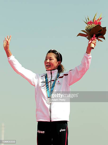 Akane Tsuchihashi of Japan celebrates with the Silver medal won in the Women's Individual Triathlon at the Triathlon Venue during day one of the 16th...