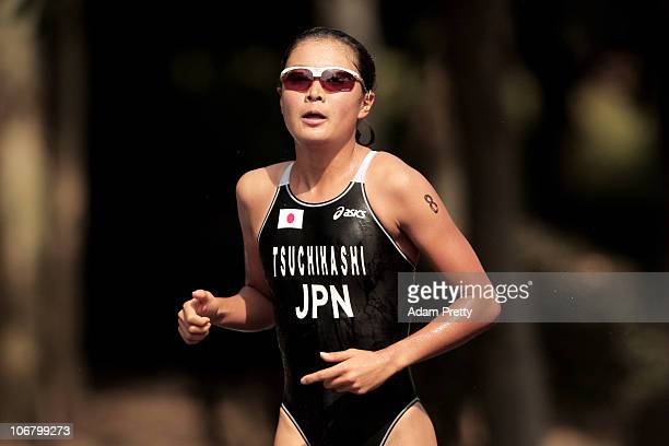 Akane Tsuchihashi of Japan competes in the Women's Individual Triathlon at the Triathlon Venue during day one of the 16th Asian Games Guangzhou 2010...