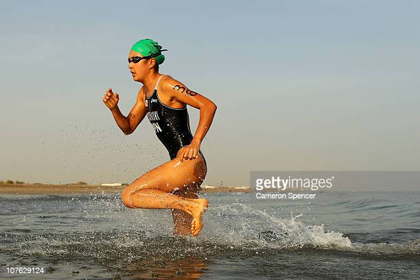 Akane Tsuchihashi of Japan runs out of the water during the swim leg of the Women's Triathlon event at North Al Hail during day nine of the 2nd Asian...