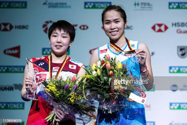 Akane Yamaguchi of Japan and Ratchanok Intanon of Thailand pose with their trophies after the Women's Single final match during day six of the Yonex...