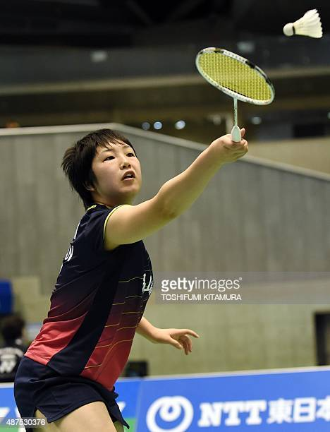 Akane Yamaguchi of Japan hits a return against Beiwen Zhang of the US during their women's singles second round match at the Japan Open Superseries...