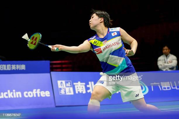 Akane Yamaguchi of Japan hits a return against Chen Yufei of China during their women's singles semifinal match at the 2019 Badminton Asia...