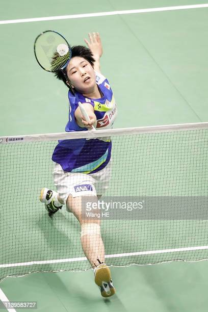 Akane yamaguchi of Japan hits a return during the games after the women's singles Semifinal match against Chen Yufei of China at the 2019 Badminton...