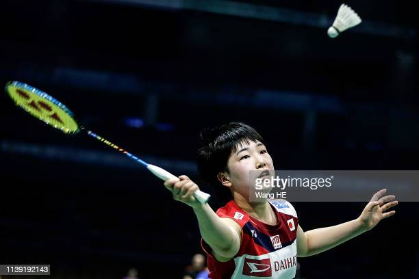 Akane Yamaguchi of Japan hits a return during the women's singles match against Yeo Jia Min of Singapore at the 2019 Badminton Asia Championships on...