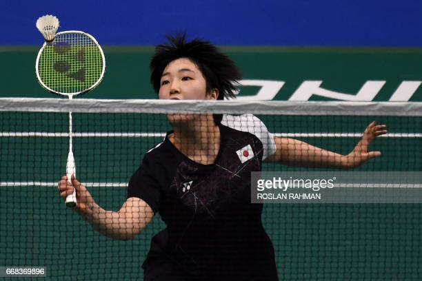 Akane Yamaguchi of Japan plays against Zhang Beiwen of the US during the women's singles quarterfinal of the Singapore Open badminton tournament in...