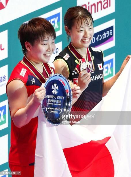 Akane Yamaguchi of Japan poses after winning the women's singles at the Japan Open in Chofu Tokyo on July 28 together with runnerup Nozomi Okuhara...