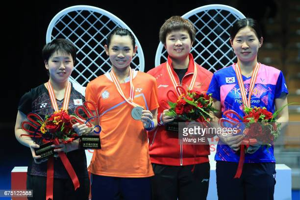 Akane Yamaguchi of Japan Tai Tzu Ying of Chinese Taipei He Bing Jiao of China and Jang Mi Lee of South Korea pose with their medals on the podium...
