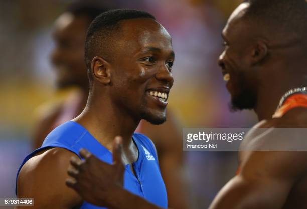 Akani Simbine of South Africa celebrates victory after the Men's 100 metres with Ben Youssef Meite of the Ivory Coast during the Doha IAAF Diamond...