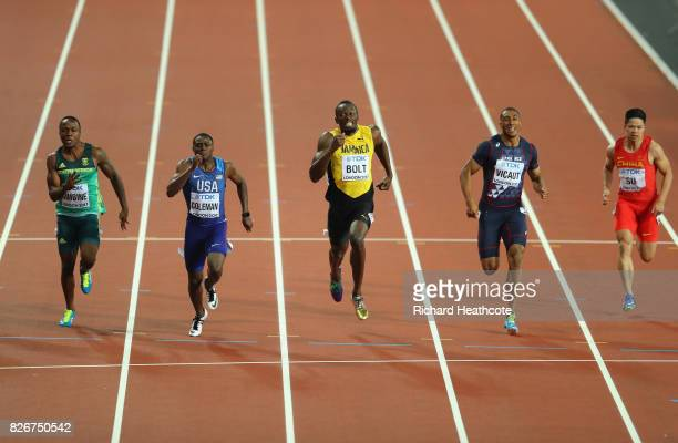 Akani Simbine of South Africa, Christian Coleman of the United States, Usain Bolt of Jamaica, Jimmy Vicaut of France and Bingtian Su of China cross...