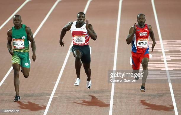 Akani Simbine of South Africa Harry AikinesAryeetey of England and Kemar Hyman of the Cayman Islands compete in the Men's 100 metres semi finals on...