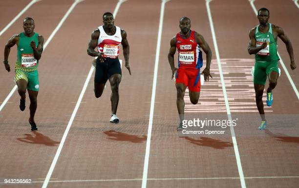 Akani Simbine of South Africa Harry AikinesAryeetey of England Kemar Hyman of the Cayman Islands and Seye Ogunlewe of Nigeria compete in the Men's...