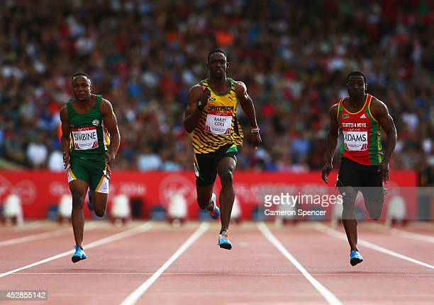 Akani Simbine of South Africa Kemar BaileyCole of Jamaica and Antoine Adams of St Kitts and Nevis compete in the Men's 100 metres semifinal at...