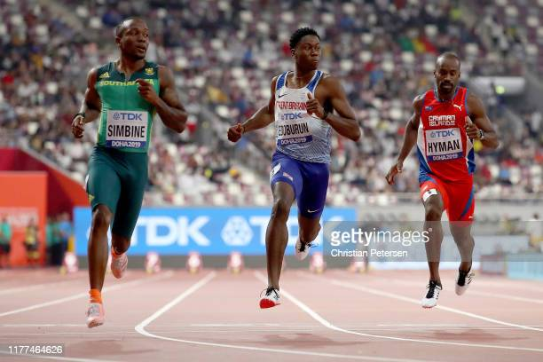 Akani Simbine of South Africa Ojie Edoburun of Great Britain and Kemar Hyman of Cayman Islands compete in the Men's 100 metres heats during day one...