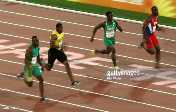 Akani Simbine of South Africa Yohan Blake of Jamaica Enoch Olaoluwa Adegoke of Nigeria Kemar Hyman of the Cayman Islands compete in the Men's 100...