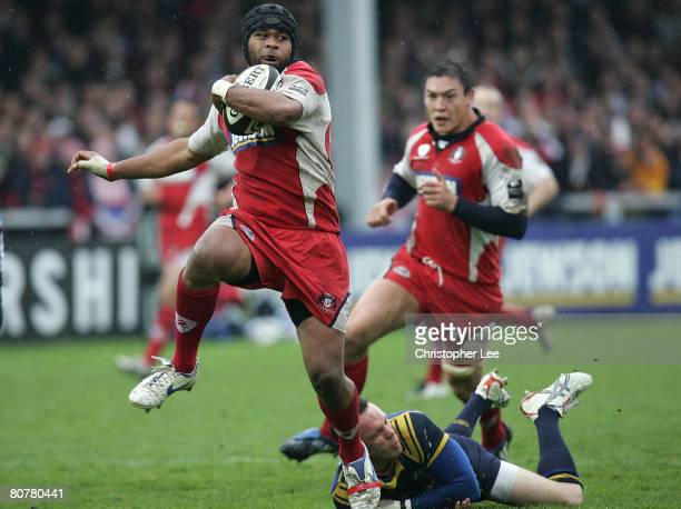 Akapusi Qera of Gloucester jumps a tackle from Leigh Hinton of Leeds during the Guinness Premiership match between Gloucester and Leeds Carnegie at...